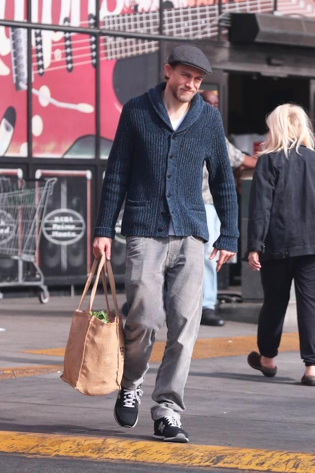 <p>Nothing says cozy like a cable-knit cardigan and a filled-to-the-brim tote bag.</p>