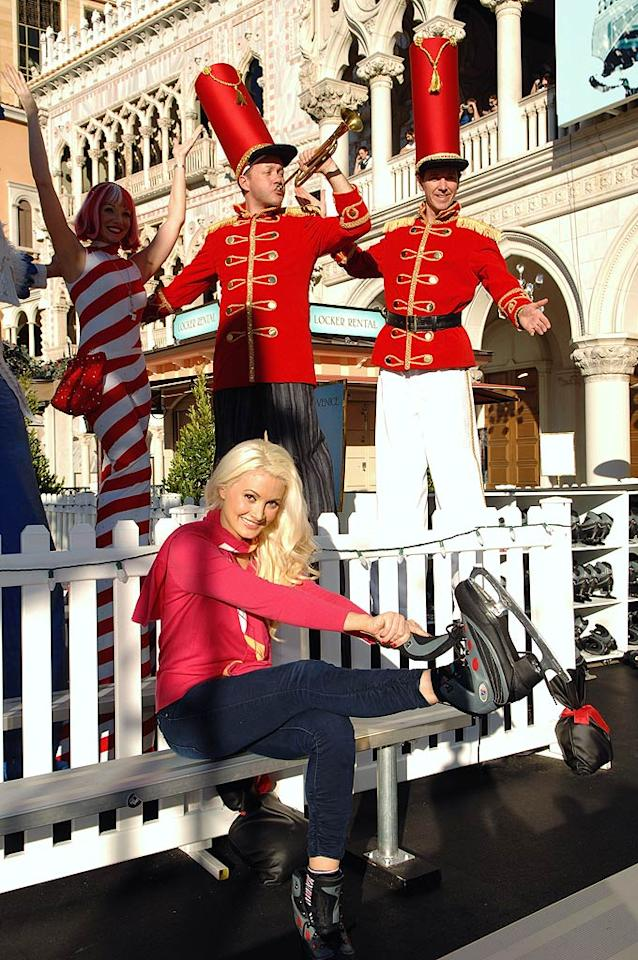 """Hugh Hefner's ex-turned-Vegas-showgirl Holly Madison got ready for a skate during the Venetian and Palazzo Resorts' """"Winter in Venice"""" fest on Tuesday. (11/29/2011)"""