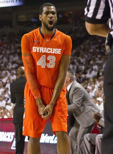 Syracuse's James Southerland reacts to a call during the second half of an NCAA college basketball game against Arkansas in Fayetteville, Ark., Friday, Nov. 30, 2012. Southerland scored a team-high 35 points as Syracuse defeated Arkansas 91-82. (AP Photo/Gareth Patterson)