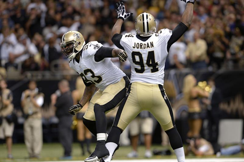 New Orleans Saints linebacker Junior Galette (93) and defensive end Cameron Jordan (94) celebrate a sack in the second half of an NFL football game against the Atlanta Falcons in New Orleans, Sunday, Sept. 8, 2013. (AP Photo/Bill Feig)