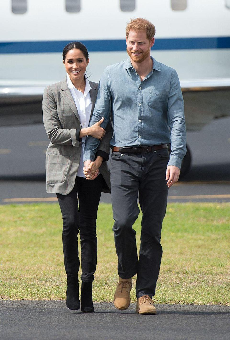 """<p>Harry and Meghan visited <a href=""""https://www.townandcountrymag.com/society/tradition/g23839991/prince-harry-meghan-markle-royal-tour-australia-day-2-photos/"""" rel=""""nofollow noopener"""" target=""""_blank"""" data-ylk=""""slk:Dubbo on day two"""" class=""""link rapid-noclick-resp"""">Dubbo on day two</a> of their royal tour. For this visit, <a href=""""https://www.townandcountrymag.com/style/fashion-trends/a23842614/meghan-markle-serena-williams-blazer-royal-tour-australia-day-2/"""" rel=""""nofollow noopener"""" target=""""_blank"""" data-ylk=""""slk:Meghan wore a"""" class=""""link rapid-noclick-resp"""">Meghan wore a</a> plaid blazer from <a href=""""https://www.serenawilliams.com/collections/outerwear/products/boss-oversized-blazer"""" rel=""""nofollow noopener"""" target=""""_blank"""" data-ylk=""""slk:her close friend Serena Williams's line"""" class=""""link rapid-noclick-resp"""">her close friend Serena Williams's line</a> over a button-down shirt by Maison Kitsune, black pants from Australian <a href=""""https://outlanddenim.com/products/harriet-in-black"""" rel=""""nofollow noopener"""" target=""""_blank"""" data-ylk=""""slk:brand Outland"""" class=""""link rapid-noclick-resp"""">brand Outland</a>, black boots from J.Crew. The Duchess also wore a pair of diamond earring by <a href=""""https://adinareyter.com/collections/earrings/products/3-diamond-amigos-curve-posts"""" rel=""""nofollow noopener"""" target=""""_blank"""" data-ylk=""""slk:Adina Reyter"""" class=""""link rapid-noclick-resp"""">Adina Reyter</a>.</p><p><a class=""""link rapid-noclick-resp"""" href=""""https://go.redirectingat.com?id=74968X1596630&url=https%3A%2F%2Fwww.jcrew.com%2Fp%2Fwomens_category%2Fshoes%2Fboots%2Fsadie-ankle-boots%2FK0039%3Fcolor_name%3Dmelted-caramel&sref=https%3A%2F%2Fwww.townandcountrymag.com%2Fstyle%2Ffashion-trends%2Fg3272%2Fmeghan-markle-preppy-style%2F"""" rel=""""nofollow noopener"""" target=""""_blank"""" data-ylk=""""slk:SHOP NOW"""">SHOP NOW </a><em>Sadie Ankle Boots by J.Crew, $178</em></p>"""
