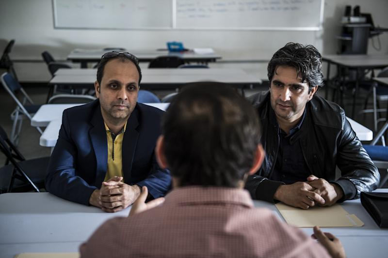 "Afghan SIV refugees Mohammad Asem Aswadi, right, and Mohammad Naim Shams, left, with engineering degrees, listen to Naimatullah Sultani, 27, center, a workforce development specialist with LAO Family Community Development, Inc., explain their 3-4 page resume is too much on Thur., Oct. 27, 2016 in Sacramento, Calif. ""An employer only wants one page,"" said Sultani. The refugees were disappointed their degrees didn't transfer to an equivalent job in the U.S. as Sultani recommended a $12 an hour warehouse job. (Photo: by Renée C. Byer/The Sacramento Bee)"
