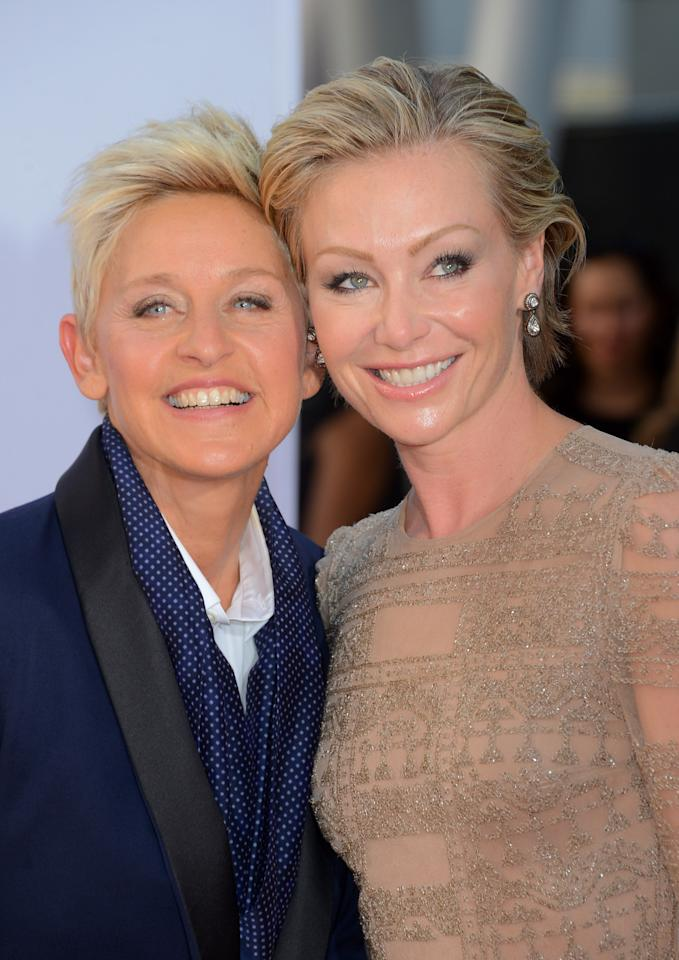 LOS ANGELES, CA - SEPTEMBER 23:  TV host Ellen DeGeneres (L) and wife Portia de Rossi arrive at the 64th Annual Primetime Emmy Awards at Nokia Theatre L.A. Live on September 23, 2012 in Los Angeles, California.  (Photo by Frazer Harrison/Getty Images)