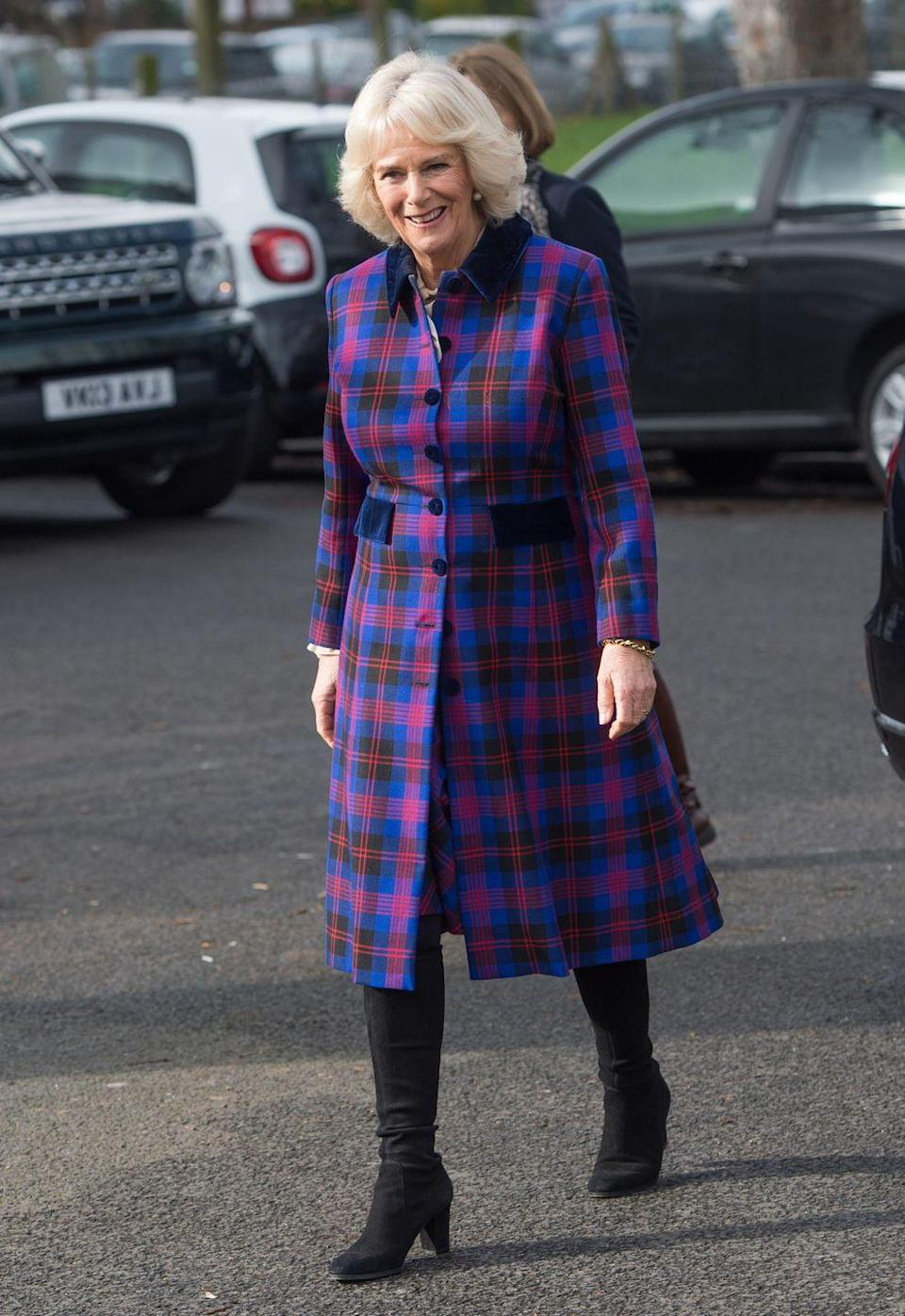 <p>Camilla opted for a plaid coat for a visit to Ebony Horse Club, embracing a bold pink and blue color palette.<br></p>