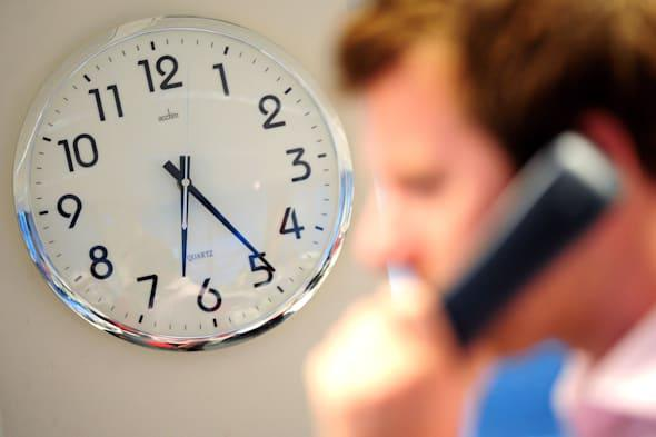 clock and man on phone