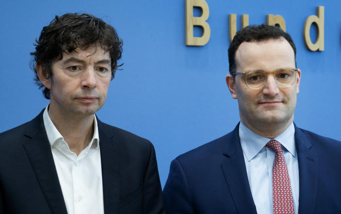 Christian Drosten, left, virologist of the Charite hospital, and German Health Minister Jens Spahn, right, arrive for a press conference on the new coronavirus in Berlin, Germany, Monday, March 9, 2020. (AP Photo/Michael Sohn)