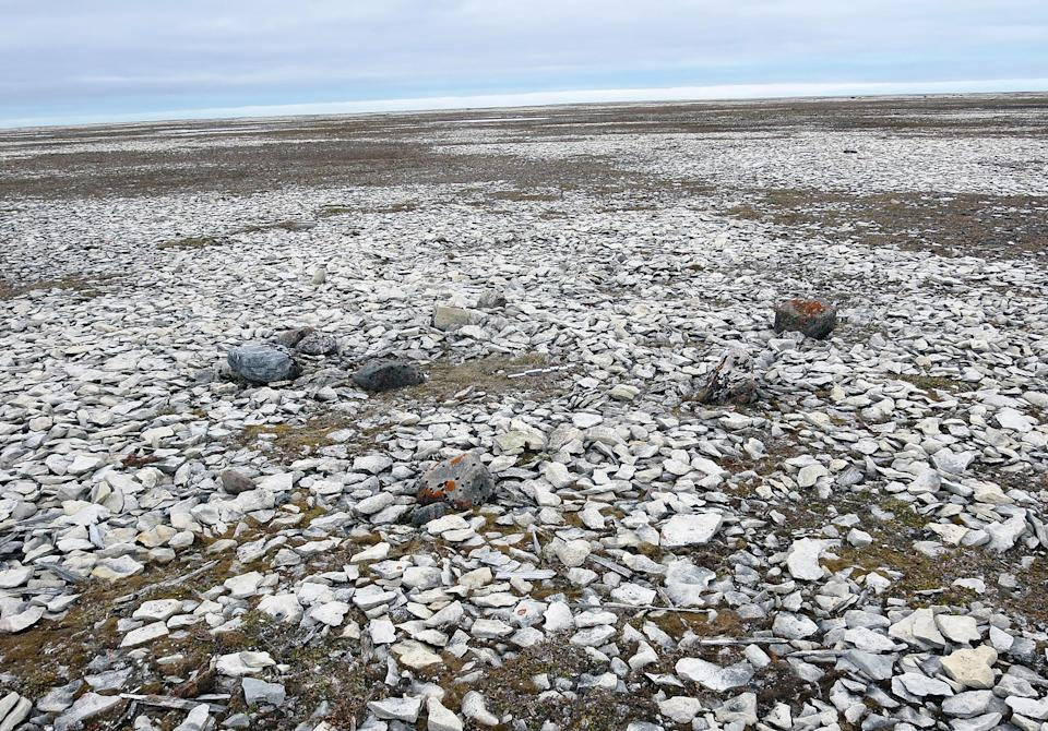 A photo provided by University of Waterloo shows a cairn containing the remains of John Gregory and two other members of the expedition on King William Island in Canada. (University of Waterloo via The New York Times)