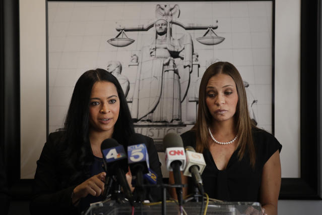 Former Olympic gymnast Tasha Schwikert, left, answers questions from the media as she is joined by sister, Jordan, who was also a member of the national team. (AP Photo/Jae C. Hong)