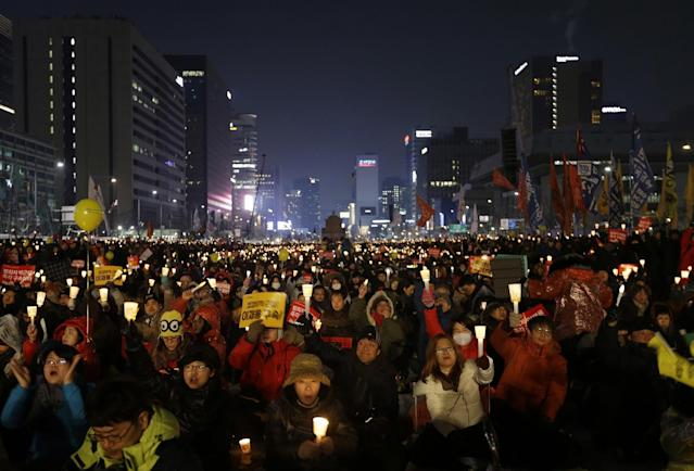 <p>In this Jan. 21, 2017, file photo, protesters stage a candlelight vigil calling for impeached President Park Geun-hye to step down in Seoul, South Korea. The PyeongChang Olympics have been drawn into the country's biggest political scandal in decades. Prosecutors say Park and her longtime friend Choi Soon-sil plotted to pressure businesses to donate tens of millions of dollars to two nonprofit foundations controlled by Choi, one of them sports-related. (AP Photo/Ahn Young-joon, File) </p>