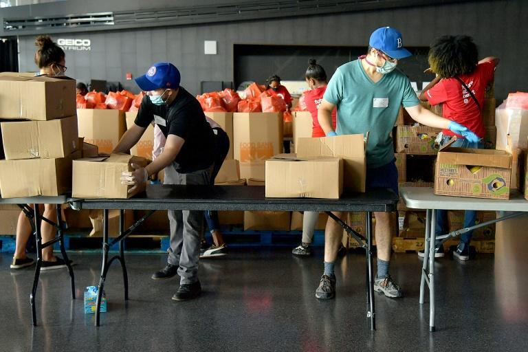New Yorkers in need receive free produce, dry goods and meat at a mobile food bank as the government reports an historic drop in US economic growth