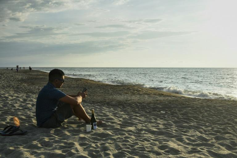 Digital nomads have traded worrying about the pandemic and battling the congestion of life in Manila for lush beaches and dawn bike rides along the Philippines' white-sand coastline