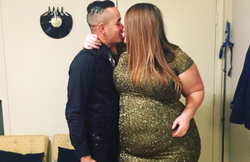 Melissa Gibson and her boyfriend ring in the new year with a kiss. (Photo via Instagram/yourstruelymelly)