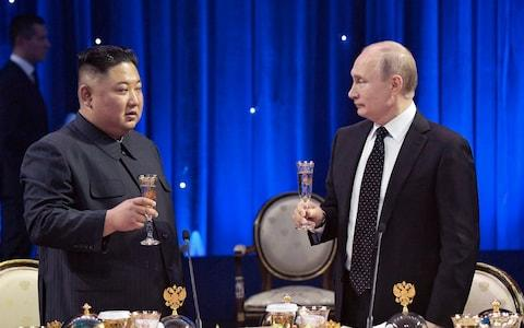 Vladimir Putin and Kim Jong-un toast during the first meeting in Vladivostok in April - Credit: Alexei Nikolsky/Sputnik, Kremlin Pool Photo via AP