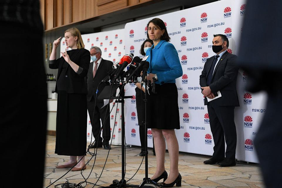 NSW Premier Gladys Berejiklian (centre) speaks to the media during a press conference to provide a COVID-19 update, in Sydney.