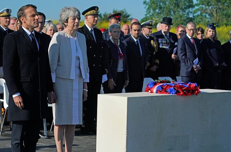 Prime Minister Theresa May and French President Emmanuel Macron at the Inauguration of the British Normandy Memorial site in Ver-sur-Mer, France, during commemorations for the 75th anniversary of the D-Day landings. PRESS ASSOCIATION Photo. Picture date: Thursday June 6, 2019. See PA story MEMORIAL DDay. Photo credit should read: Owen Humphreys/PA Wire