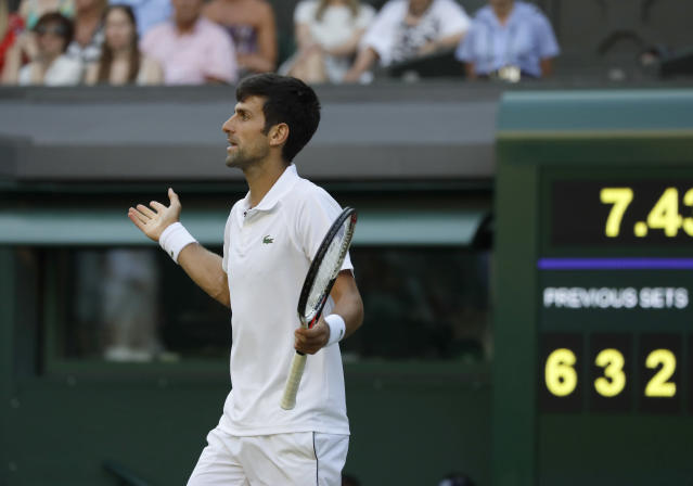 Serbia's Novak Djokovic complains to the umpire during his men's singles match against Kyle Edmund of Great Britain, on the sixth day of the Wimbledon Tennis Championships in London, Saturday July 7, 2018. (AP Photo/Kirsty Wigglesworth)