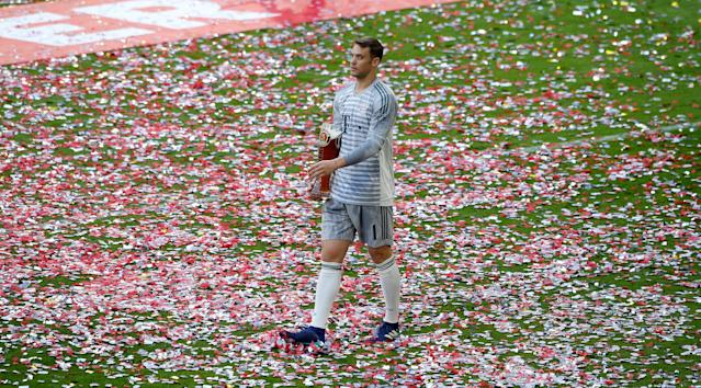Soccer Football - Bundesliga - Bayern Munich v VfB Stuttgart - Allianz Arena, Munich, Germany - May 12, 2018 Bayern Munich's Manuel Neuer celebrates winning the Bundesliga REUTERS/Michaela Rehle DFL RULES TO LIMIT THE ONLINE USAGE DURING MATCH TIME TO 15 PICTURES PER GAME. IMAGE SEQUENCES TO SIMULATE VIDEO IS NOT ALLOWED AT ANY TIME. FOR FURTHER QUERIES PLEASE CONTACT DFL DIRECTLY AT + 49 69 650050