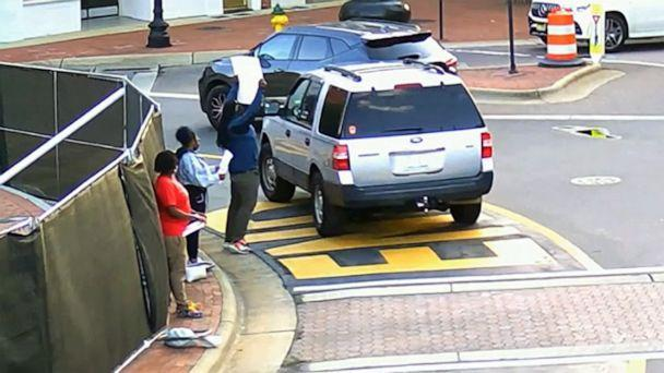 PHOTO: Surveillance video released by police shows an SUV driving around a traffic circle in Fayetteville, N.C., passing close to a group of Black Lives Matter protesters, May 7, 2021. (Fayetteville Police Department)
