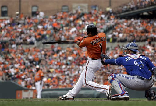 Baltimore Orioles' Brian Roberts doubles in the fourth inning of a baseball game against the Toronto Blue Jays, Saturday, July 13, 2013, in Baltimore. Chris Davis scored on the play. (AP Photo/Patrick Semansky)