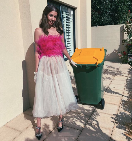 lissygraham_ taking out the bins in a dress