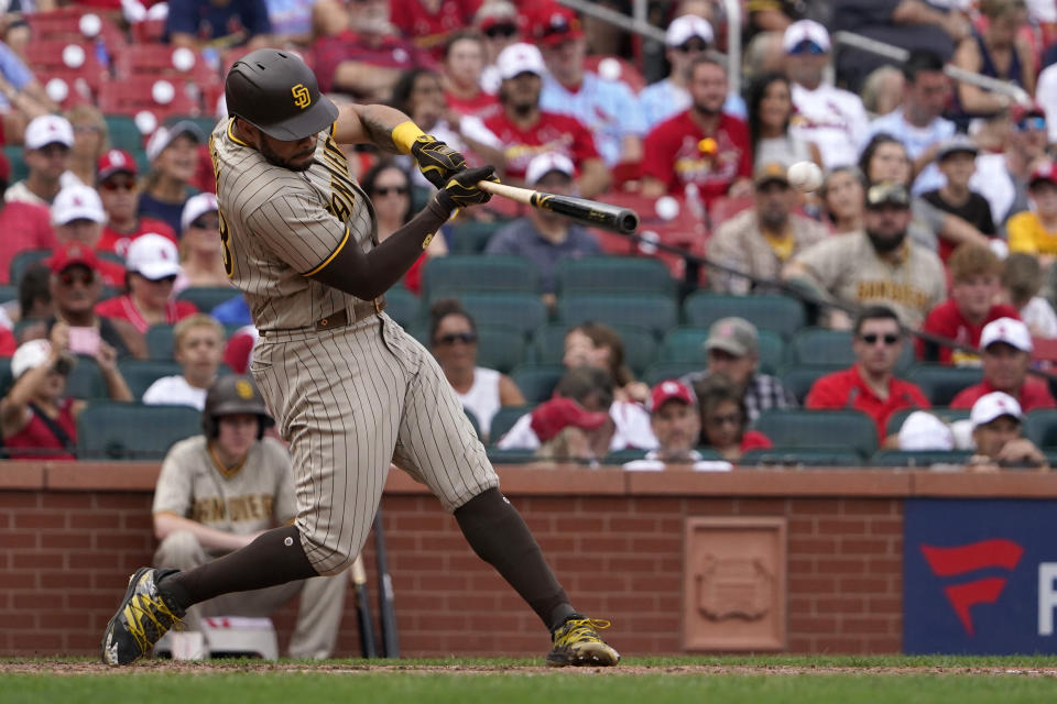 San Diego Padres' Tommy Pham hits a two-run double during the eighth inning of a baseball game against the St. Louis Cardinals Sunday, Sept. 19, 2021, in St. Louis. Pham went on to third on the throw. (AP Photo/Jeff Roberson)