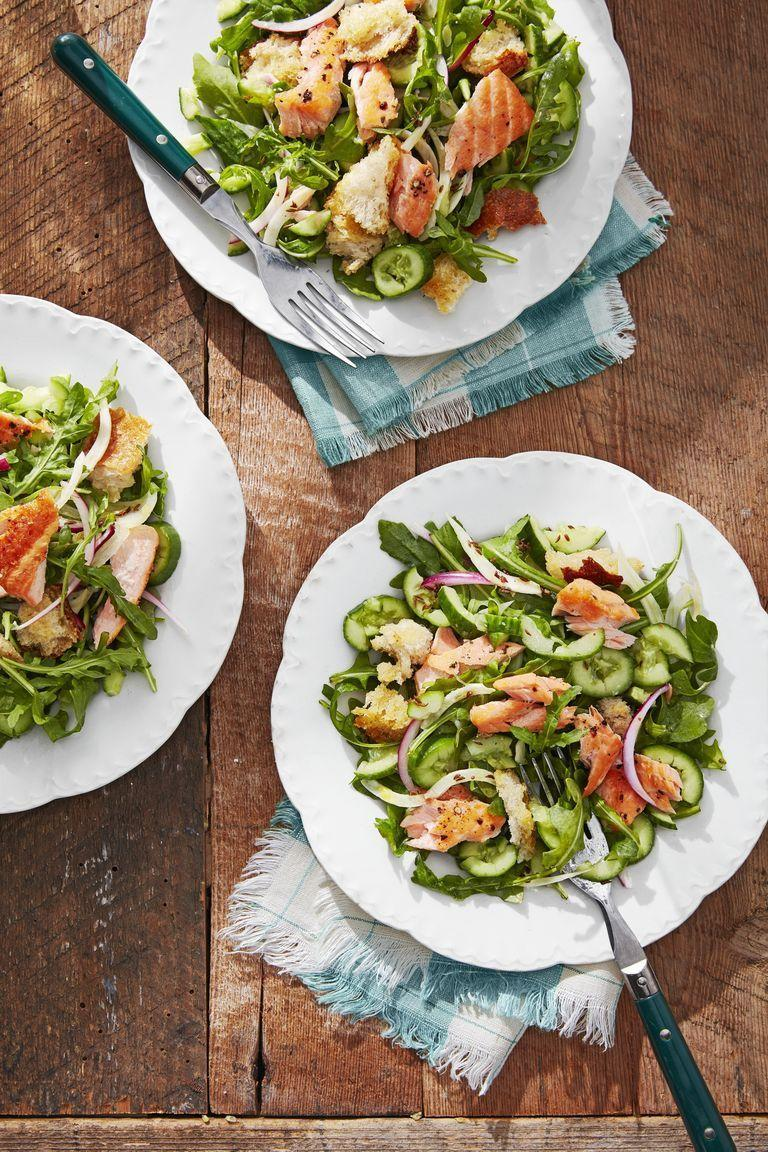 """<p>Made with cucumbers and quick-cooking salmon, this salad is as refreshing as it is easy to put together. Add the toasted bread of your choice for a satisfying crunch.</p><p><strong><a href=""""https://www.countryliving.com/food-drinks/a28609207/cucumber-salmon-panzanella-recipe/"""" rel=""""nofollow noopener"""" target=""""_blank"""" data-ylk=""""slk:Get the recipe"""" class=""""link rapid-noclick-resp"""">Get the recipe</a>.</strong> </p>"""