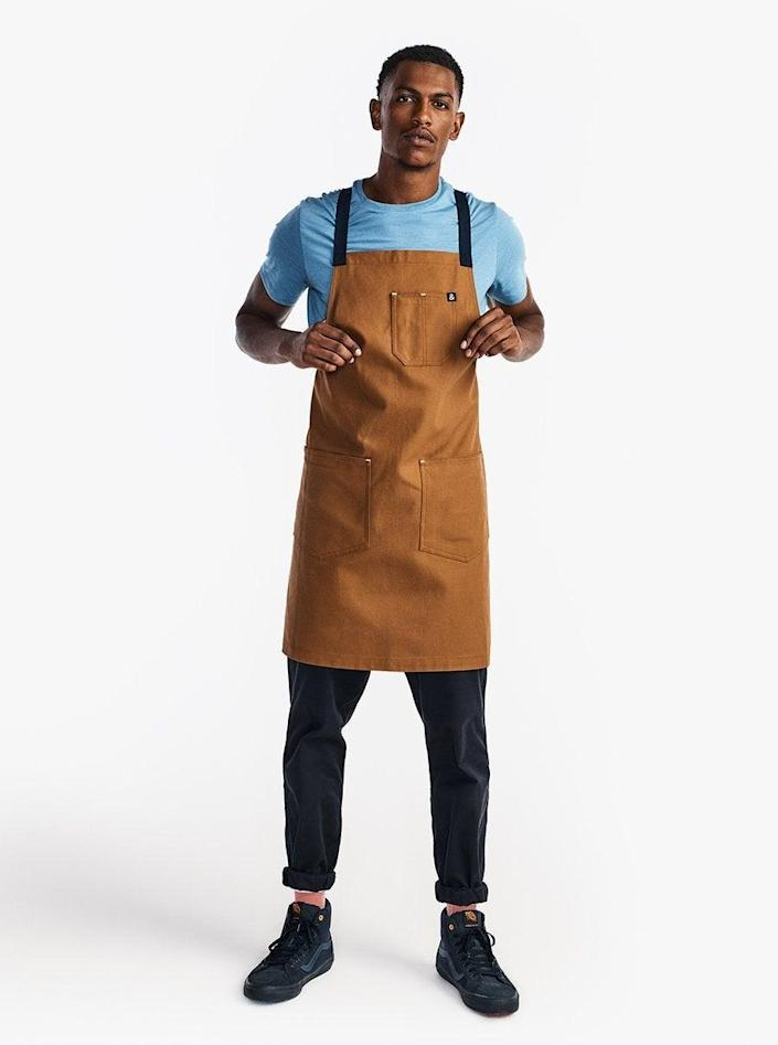 """<h2>Hedley & Bennett Crossback Apron</h2><br>He'll appreciate feeling comfortable while enjoying his craft. This durable 100% cotton canvas apron has been road-tested and approved by many a chef. It can also be customized for an additional cost. Aprons at Hedley & Bennett start at $85, and we also suggest checking out <a href=""""https://www.hedleyandbennett.com/collections/gifts-for-mom/products/the-cook-bundle"""" rel=""""nofollow noopener"""" target=""""_blank"""" data-ylk=""""slk:the cook's bundle"""" class=""""link rapid-noclick-resp"""">the cook's bundle</a> for a sharp gift.<br><br><em>Shop <strong><a href=""""https://www.hedleyandbennett.com/"""" rel=""""nofollow noopener"""" target=""""_blank"""" data-ylk=""""slk:Hedley & Bennett"""" class=""""link rapid-noclick-resp"""">Hedley & Bennett</a></strong></em><br><br><strong>Hedley & Bennett</strong> The All Day Crossback Apron, $, available at <a href=""""https://go.skimresources.com/?id=30283X879131&url=https%3A%2F%2Fwww.hedleyandbennett.com%2Fproducts%2Fthe-all-day-crossback-apron-denver"""" rel=""""nofollow noopener"""" target=""""_blank"""" data-ylk=""""slk:Hedley & Bennett"""" class=""""link rapid-noclick-resp"""">Hedley & Bennett</a>"""