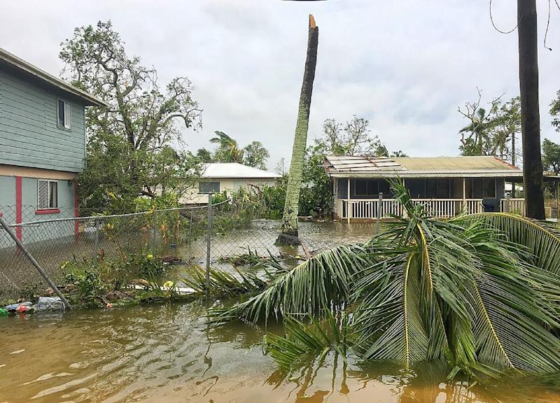 Severe Cyclone Gita unleashed 230 kmh (142 mph) winds on Tonga's most populous island, tearing roofs off buildings, downing powerlines and causing extensive flooding (AFP Photo/Virginie DOURLET)