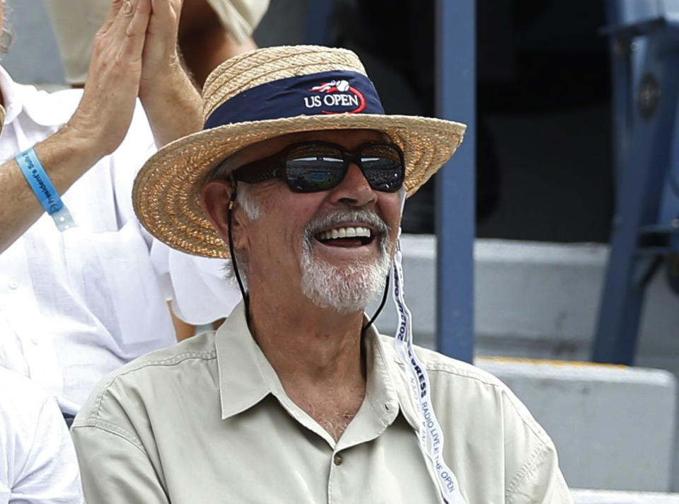 Actor Sean Connery watches from the gallery at the U.S. Open tennis tournament in New York September 6, 2012. REUTERS/Mike Segar (UNITED STATES  - Tags: SPORT TENNIS ENTERTAINMENT)