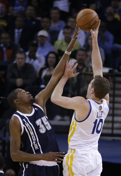 Oklahoma Thunder forward Kevin Durant, left, reaches to block the shot of Golden State Warriors' David Lee during the first half of an NBA basketball game Thursday, April 11, 2013, in Oakland, Calif. (AP Photo/Ben Margot)