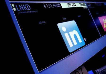 The ticker symbol and trading information for LinkedIn Corp. is displayed on a screen on the floor of the NYSE