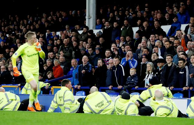 "Soccer Football - Premier League - Everton v Newcastle United - Goodison Park, Liverpool, Britain - April 23, 2018 Everton's Jordan Pickford gestures as Newcastle United fans look on Action Images via Reuters/Lee Smith EDITORIAL USE ONLY. No use with unauthorized audio, video, data, fixture lists, club/league logos or ""live"" services. Online in-match use limited to 75 images, no video emulation. No use in betting, games or single club/league/player publications. Please contact your account representative for further details."