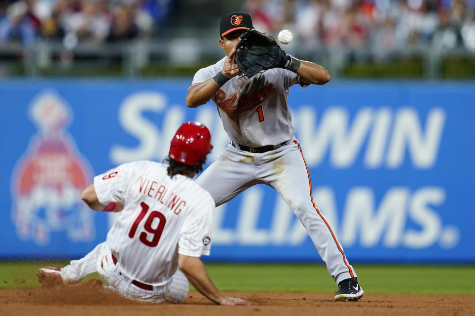 Baltimore Orioles shortstop Richie Martin, right, forces out Philadelphia Phillies' Matt Vierling at second base on a fielder's choice hit into by Didi Gregorius during the seventh inning of an interleague baseball game, Monday, Sept. 20, 2021, in Philadelphia. Gregorius was safe at first on the play. (AP Photo/Matt Slocum)