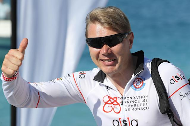 "Former Finnish formula 1 driver Mika Hakkinen gestures prior to compete in the first ""Riviera water bike challenge"", a cycling race between Nice and Monaco, in Nice, southeastern France, on June 4, 2017. / AFP PHOTO / VALERY HACHE (Photo credit should read VALERY HACHE/AFP via Getty Images)"