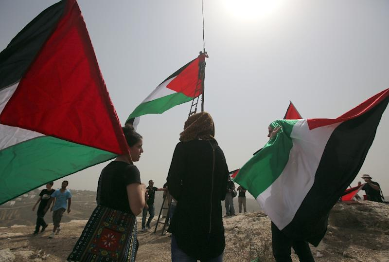 The General Assembly voted September 10 to allow the flags of Palestine, pictured, and the Vatican -- both have observer status -- to be raised at the world body alongside those of member states (AFP Photo/Abbas Momani)