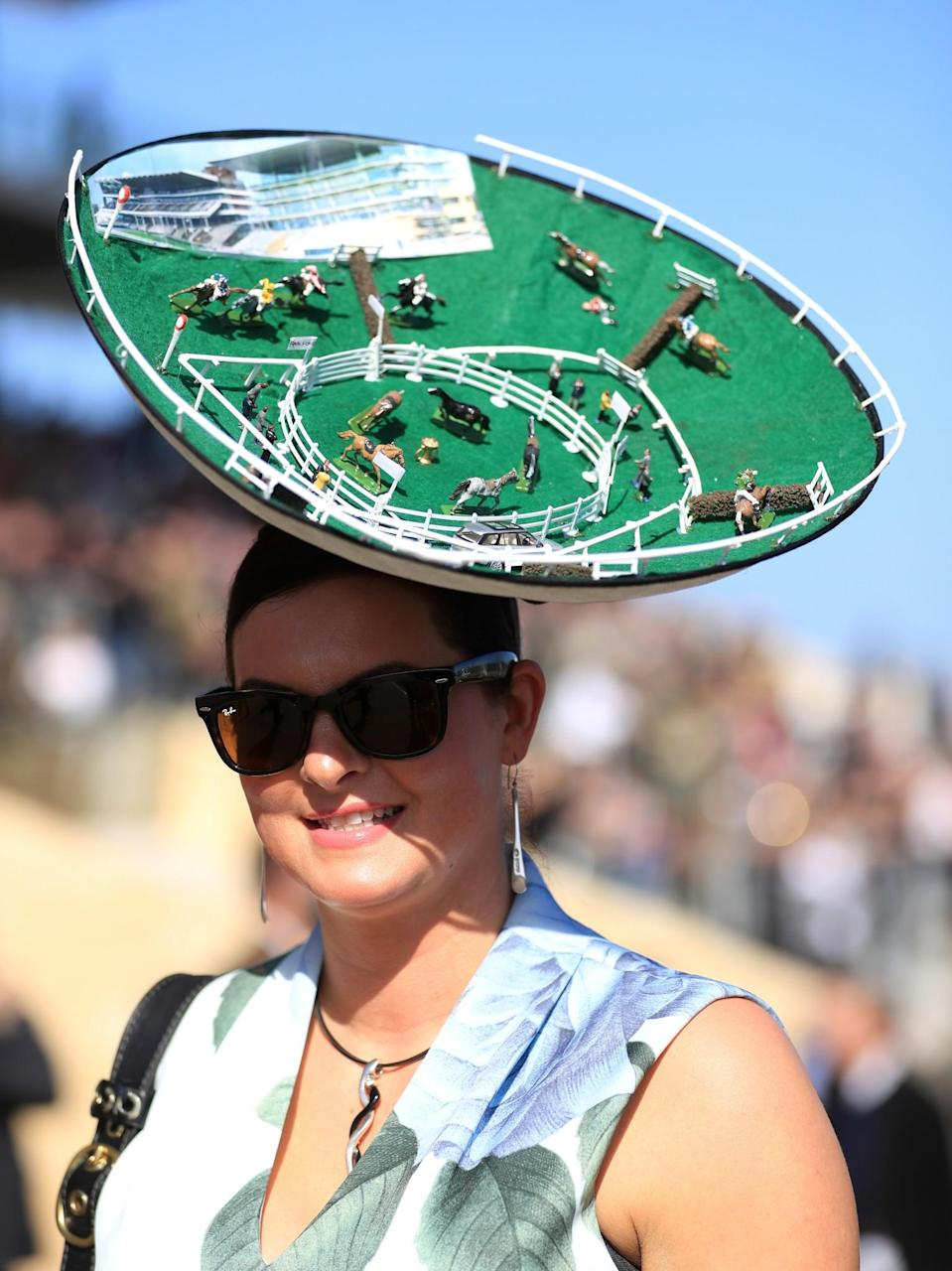 <p>Why wear something to the racecourse when you can wear the racecourse? [Photo: PA] </p>