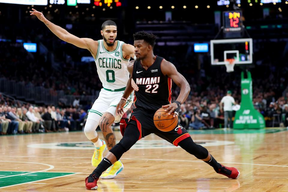 Celtics star Jayson Tatum and Heat counterpart Jimmy Butler each missed one of their teams' three meetings this season. (Maddie Meyer/Getty Images)