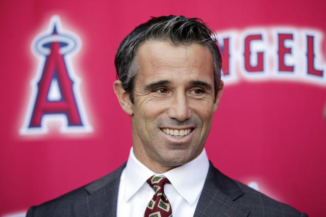FILE - In this Monday, Oct. 22, 2018, file photo, new Los Angeles Angels manager Brad Ausmus smiles while talking to reporters during a news conference in Anaheim, Calif. The former Detroit manager already got a jump on his new job as a special assistant to general manager Billy Eppler, watching up close while the Angels completed their third straight losing season. He already has ideas about how to change it when the Angels get back to work. (AP Photo/Jae C. Hong, File)