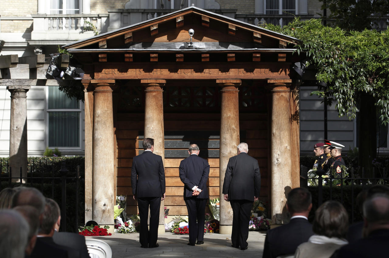 Britain's Prince Charles, centre, with Britain's Prime Minister David Cameron, left, and U.S. Ambassador Louis Susman, right, as they attend a ceremony at the 9/11 Memorial Garden in London, to mark the 10th anniversary of the U.S. attacks, Sunday Sept. 11, 2011.  (AP Photo / Luke MacGregor)