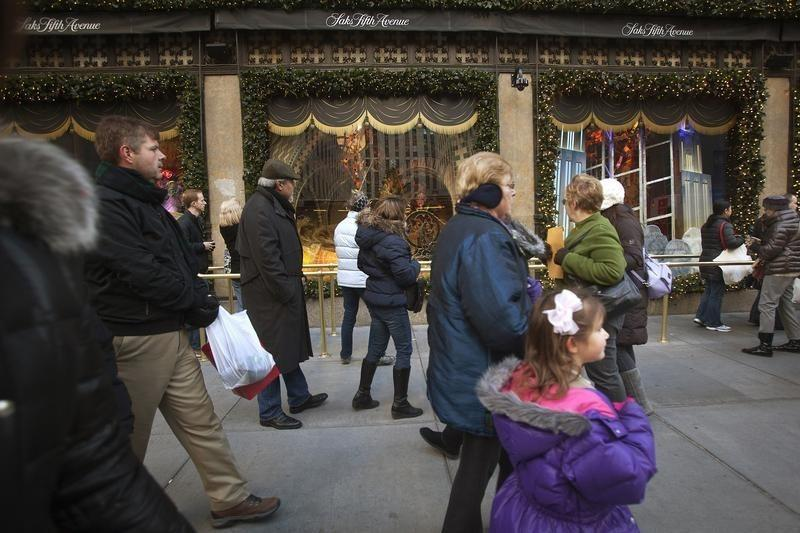 Shoppers walk up 5th Avenue past Saks Fifth Avenue on Black Friday in New York