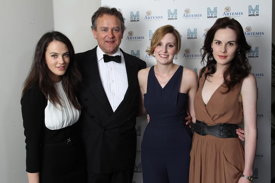 LONDON, ENGLAND - JULY 14: (EXCLUSIVE COVERAGE) L-R Jessica Brown Findlay, Hugh Bonneville, Laura Carmichael and Michelle Dockery attend an Evening With Downton Abbey - Raising Money For Merlin - The Medical Relief Charity at The Savoy Hotel on July 14, 2011 in London, United Kingdom. (Photo by Dave J Hogan/Getty Images)
