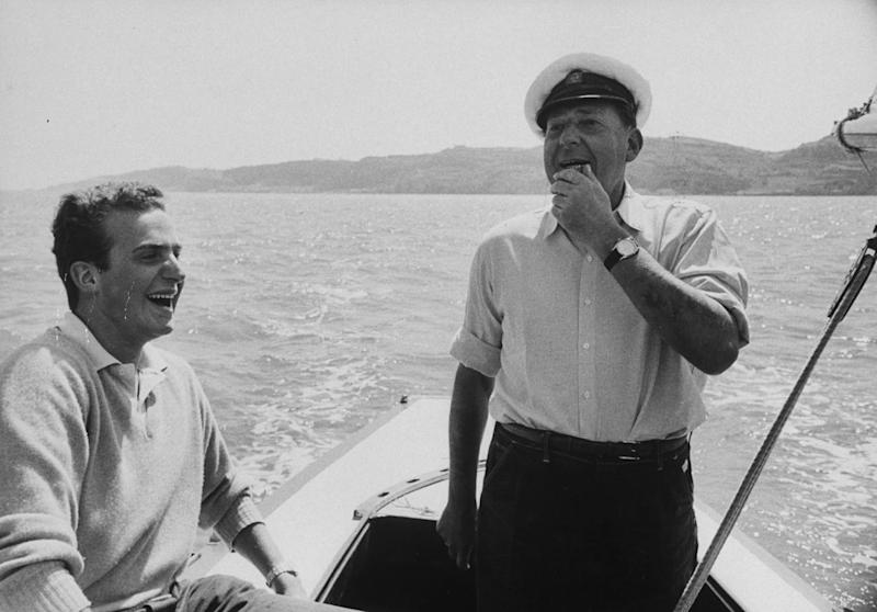 Don Juan (R) sailing with his son Prince Juan Carlos (L). (Photo by Loomis Dean/The LIFE Picture Collection via Getty Images)