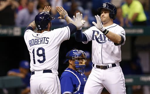 Tampa Bay Rays' Evan Longoria, right, is congratulated by teammate Ryan Roberts in front of Toronto Blue Jays catcher Henry Blanco after his grand slam home run during the third inning of a baseball game Monday, May 6, 2013, in St. Petersburg, Fla. (AP Photo/Mike Carlson)