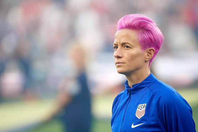 Megan Rapinoe watched silently during the national anthem in 2019. (Photo by Hannah Foslien/Getty Images)