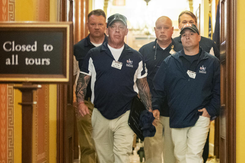 Sept. 11 first responders John Feal, front left, Ret. Lt. Michael O'Connell, front right, and other first responders leave the office of Senate Majority Leader Mitch McConnell, following their meeting at McConnell's office on Capitol Hill in Washington, Tuesday, June 25, 2019. (AP Photo/Manuel Balce Ceneta)