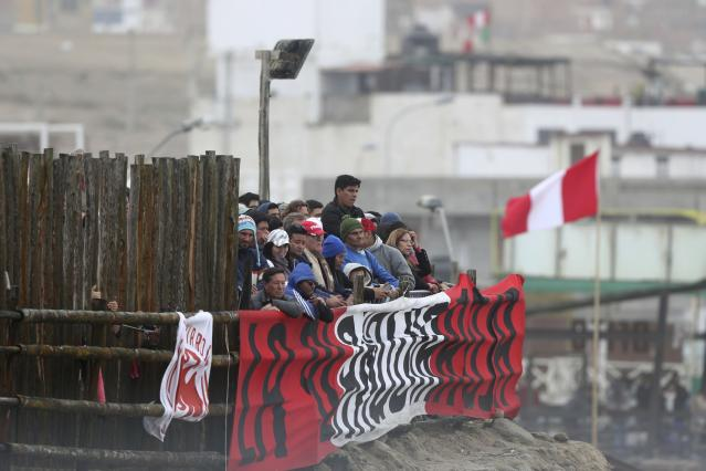 Surfing fans watch the competition during the Pan American Games on Punta Rocas beach in Lima Peru, Sunday, Aug. 4, 2019. (AP Photo/Martin Mejia)