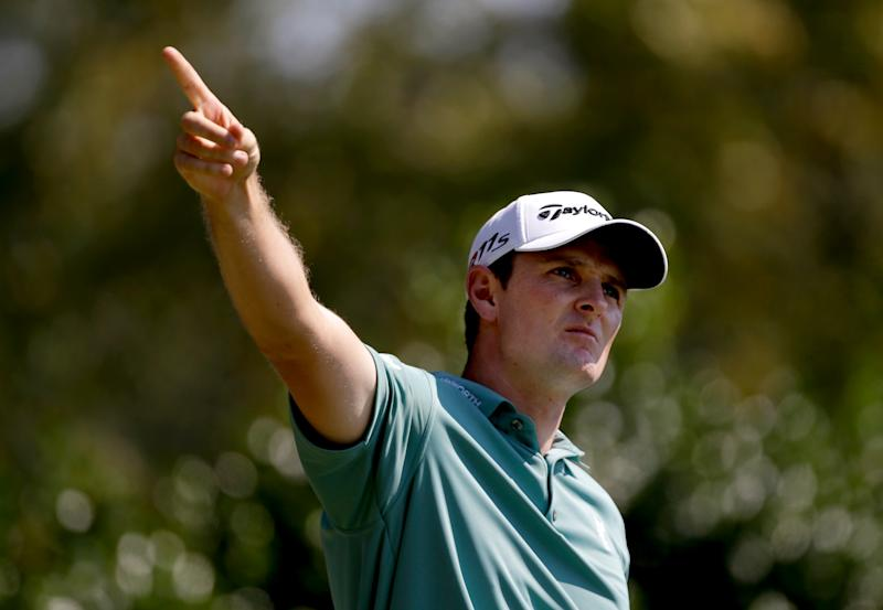 Justin Rose, of England, gestures as he watches his shot after teeing off the third hole during the third round of the Tour Championship golf tournament Saturday, Sept. 22, 2012, in Atlanta. (AP Photo/David Goldman)