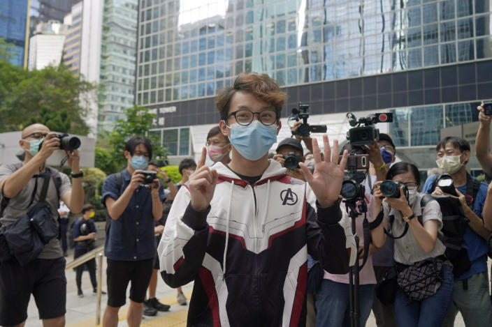 """Various defendants including pro-democracy activist Figo Chan Ho-wun arrives at a court in Hong Kong, Monday, May 17, 2021. Trial starts for Jimmy Lai and nine others, accused of """"incitement to knowingly take part in an unauthorized assembly"""" for a protest march on Oct. 1, 2019. The court has estimated 10 days for this trial. (AP Photo/Kin Cheung)"""