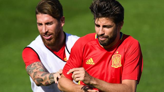 Barcelona's Gerard Pique can expect a hug from Real Madrid's Sergio Ramos on international duty with Spain.
