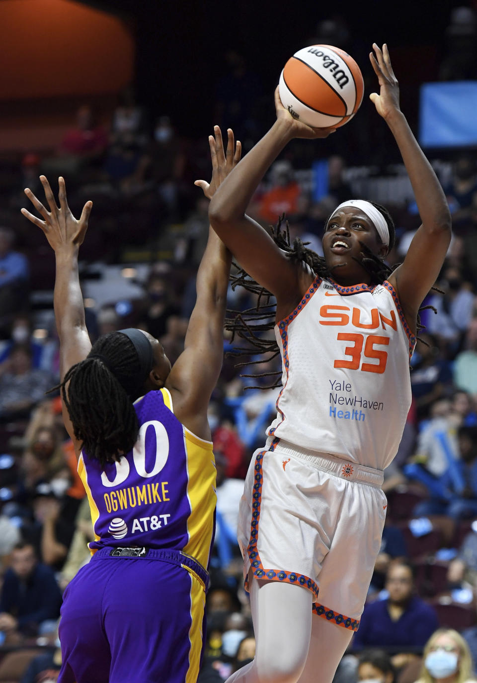 FILE - Connecticut Sun forward Jonquel Jones (35) shoots over Los Angeles Sparks forward Nneka Ogwumike (30) during a WNBA basketball game in Uncasville, Conn., in this Saturday, Aug. 28, 2021, file photo. This year, the 6-foot-6 Jones is the unanimous choice AP Player of the Year honors by the 14-member panel, announced Wednesday, Sept. 22, 2021. (Sean D. Elliot/The Day via AP, File)